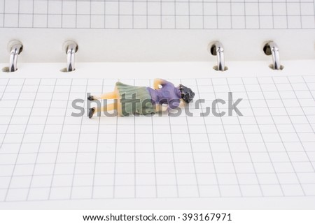 Human figure on a white spiral notebook