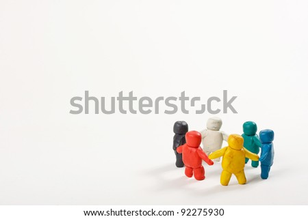 human figures from clay stand in a circle - stock photo