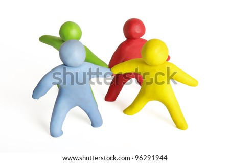Human figures from plasticine standing in a circle - stock photo