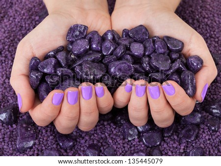 Human Fingers With Beautiful Manicure In Purple Color - stock photo