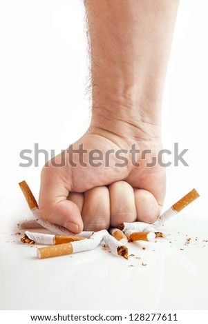 Human fist breaking cigarettes Anti smoking concept - stock photo