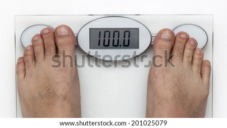 Human Foot on the Weight Scale isolated on White