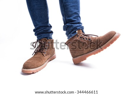 Human foot with brown leather shoes and jeans - stock photo