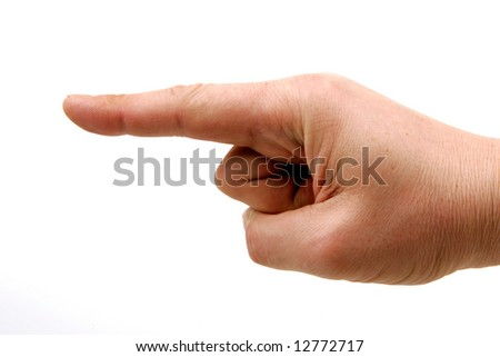 human forefinger of the right hand pointing to the left - stock photo