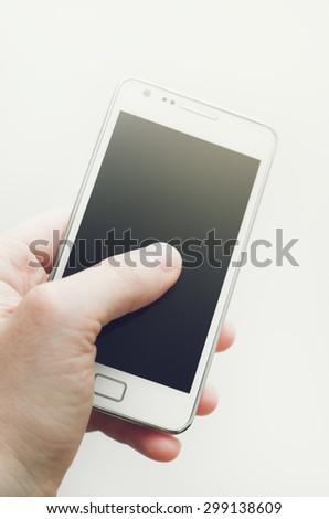 Human hand and blank smartphone screen - stock photo