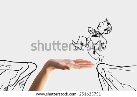Human hand and caricature of businessman jumping above gap - stock photo