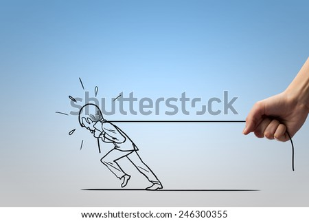 Human hand and caricature of man pulling rope - stock photo