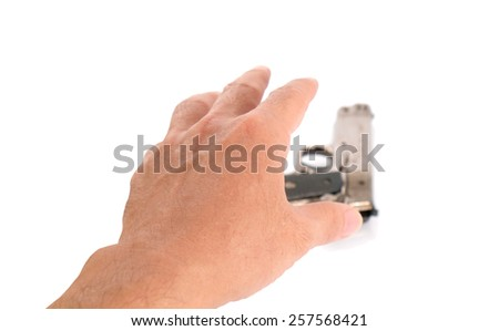 Human hand and gun on white background.