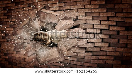 Human hand breaking brick wall. Strength and power - stock photo