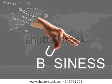 Human hand connecting letters of word business - stock photo