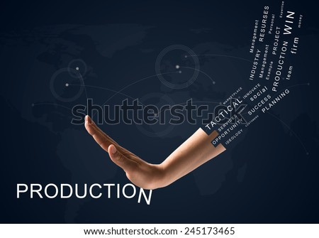 Human hand connecting letters of word production - stock photo