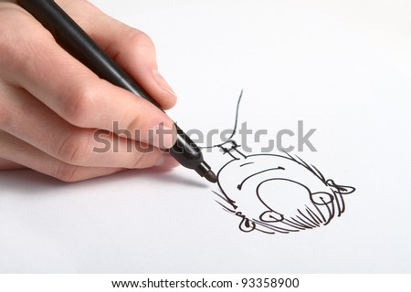 Human Hand drawing caricature of man - stock photo