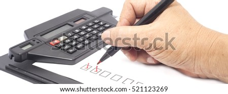 human hand drawing red check mark in checklist box