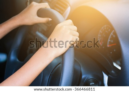 Human hand drive car.process in vintage color tone - stock photo