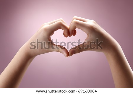 Human hand forming a love symbol. - stock photo