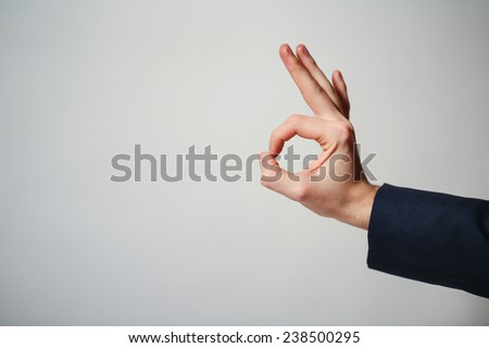 Human hand gesture is all right everything is OK. - stock photo