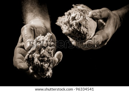 Human Hand giving a piece of bread - stock photo