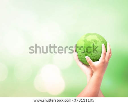 Human hand hold globe grass on beautiful nature background. Environment Rights Day World Religion Cancer CSR Go Green Earth Hour Trust Love Thanking Learning Health Care Charity Life Unity concept - stock photo