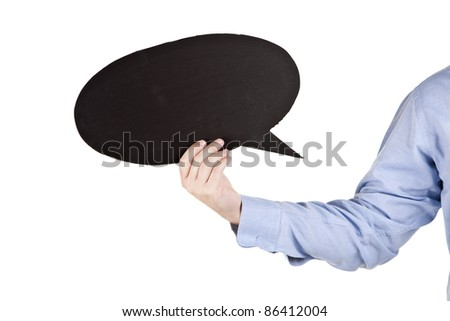 human hand holding a black speech balloon - stock photo