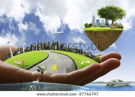human hand holding a city - stock photo