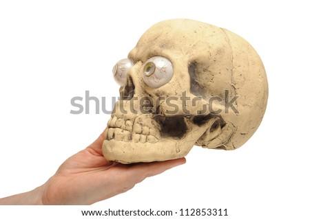 Human hand holding a halloween skull - stock photo