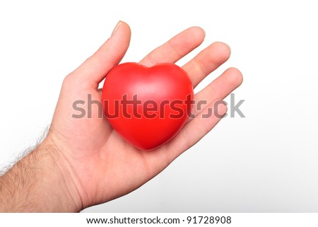 human hand holding a heart in sign of protection
