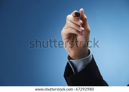 Human hand holding a marker pen - stock photo