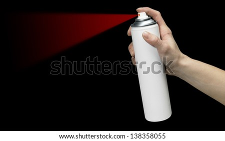 human hand holding a unlabeled white aerosol can with red spray in black back - stock photo