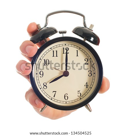 Human Hand Holding Alarm Clock On White Background - stock photo