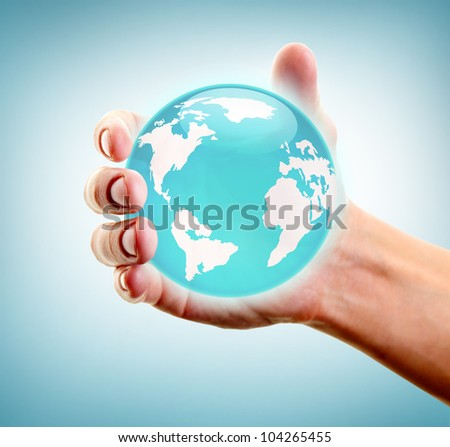 Human hand holding and showing earth