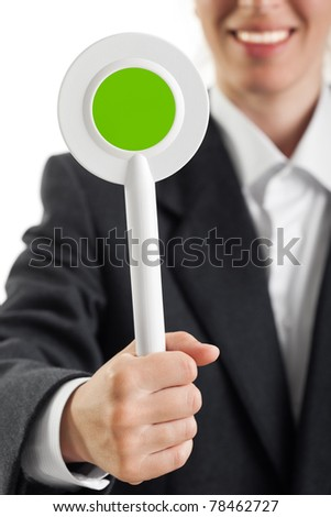 Human hand holding auction paddle voting card sign - stock photo