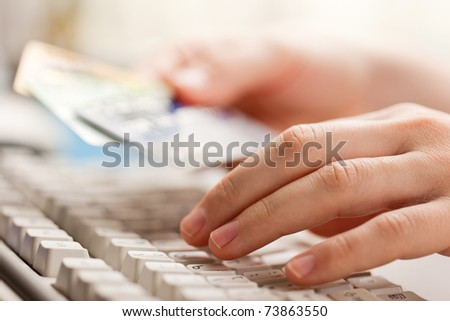 Human hand holding business finance credit cards - stock photo