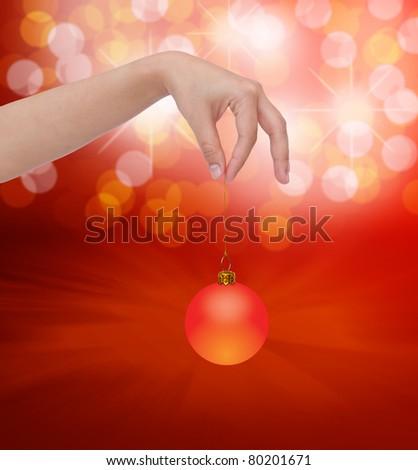 Human hand holding christmas ball - stock photo