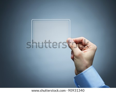 Human hand holding futuristic, transparent business card - stock photo