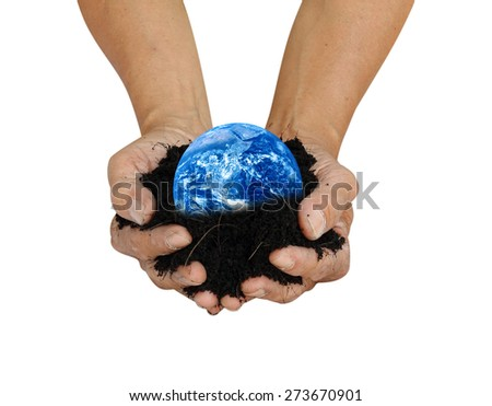 Human hand holding global in soil for think earth concept Elements of this image furnished by NASA - stock photo
