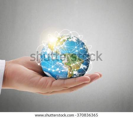 Human hand holding  globe  Elements of this image furnished by NASA - stock photo