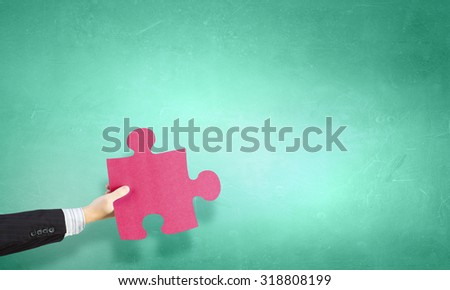 Human hand holding in palm puzzle elements