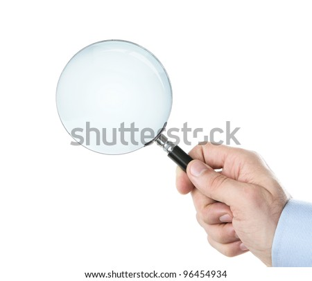 Human hand holding magnifying glass with clipping path for the inside - stock photo
