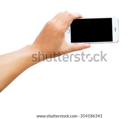 Human hand holding mobile smart phone on white background