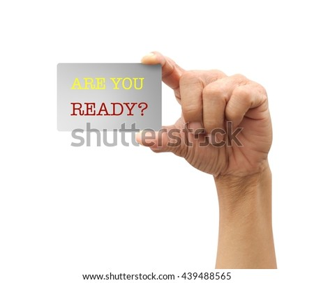 Human hand holding motivation card asking! Are you ready?