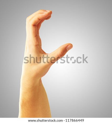 Human Hand Holding On Gray Background - stock photo