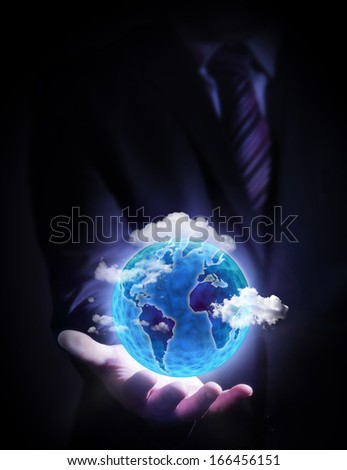 Human hand holding our planet earth glowing  - stock photo
