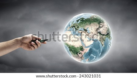 Human hand holding screwdriver. Elements of this image are furnished by NASA - stock photo