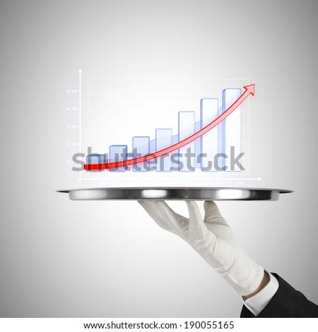 human hand holding silver plate with chart - stock photo
