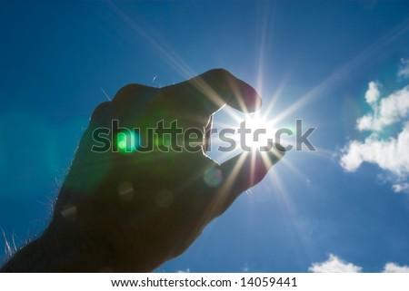 Human hand holding Sun. - stock photo