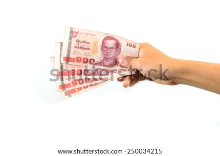 Human hand holding Thai banknotes, isolated on white background