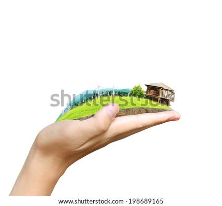 human hand holding the city  - stock photo