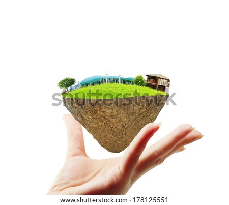 human hand holding the house - stock photo
