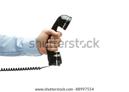 Human hand holding vintage telephone, isolated on white with copy space - stock photo