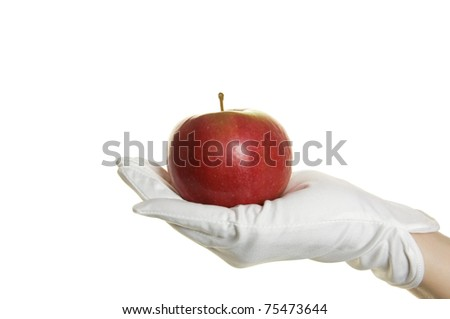 Human hand in glove with apple isolated over white